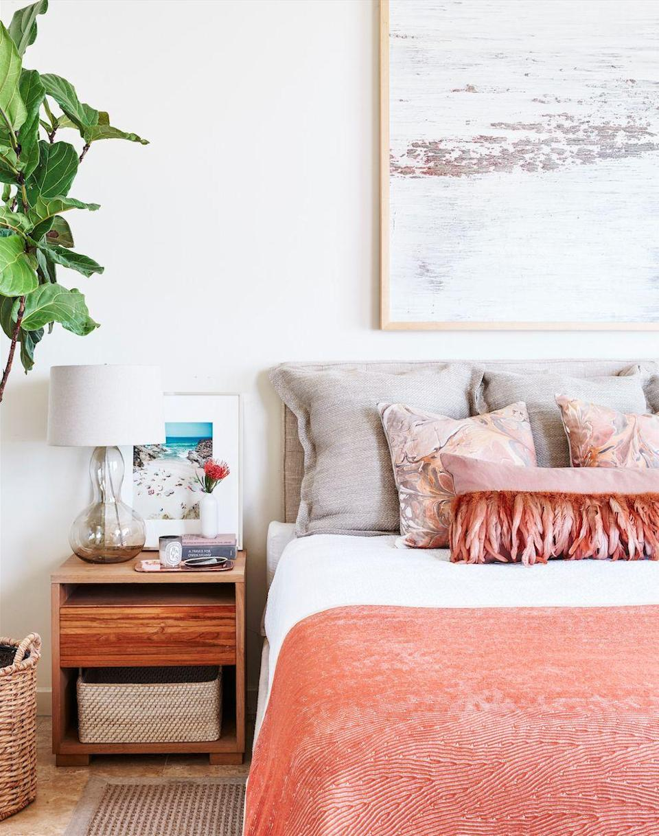 "<p>If you're always dreaming of an ocean vacation, swap in new throws and pillows for a <a href=""https://www.goodhousekeeping.com/home/decorating-ideas/g3365/ways-to-brighten-up-your-home/ "" rel=""nofollow noopener"" target=""_blank"" data-ylk=""slk:seasonal change"" class=""link rapid-noclick-resp"">seasonal change</a>. Or switch up the bedside table by adding a new piece of art, no hammering required. </p>"