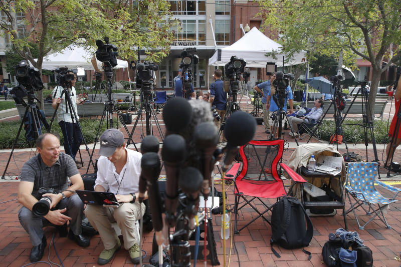 Members of the media as set up outside of federal court as jury deliberations are set to begin in the trial of former Trump campaign chairman Paul Manafort in Alexandria Va. Thursday Aug. 16 2018