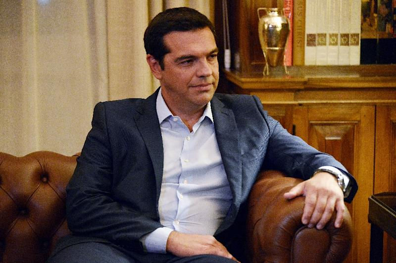 Greek Prime Minister Alexis Tsipras presents his resignation to the Greek president at the presidental palace in Athens on August 20, 2015 (AFP Photo/Louisa Gouliamaki)