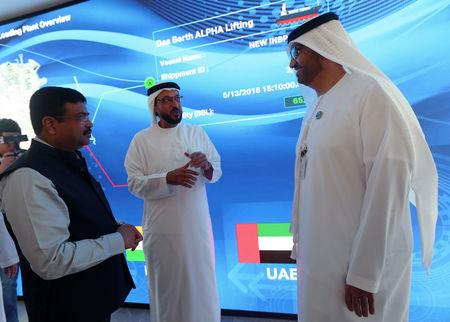 Indian Oil Minister Dharmendra Pradhan and Sultan Ahmed Al Jaber, UAE Minister of State and ADNOC Group CEO, talk during the first cargo loading between ADNOC & ISPRL at the Panorama Digital Command Centre at the ADNOC headquarters in Abu Dhabi