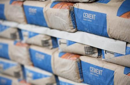 Bags of cement are seen at the Vauxhall depot of building material supplier Travis Perkins in London