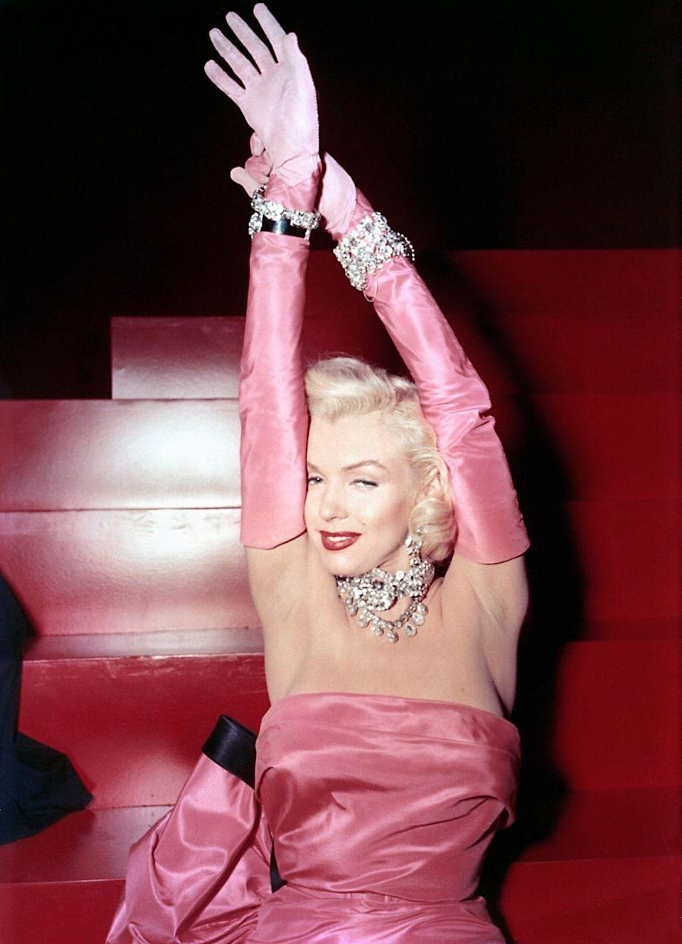 "<p>Pretty in pink while singing ""Diamonds Are a Girl's Best Friend,"" in the 1953 film <em>Gentlemen Prefer Blondes.</em></p>"