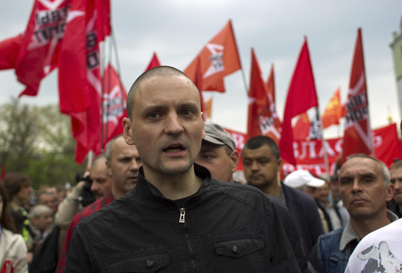 "Opposition leader Sergei Udaltsov, center, leads an opposition rally in the center of Moscow, Russia, Sunday, May 6, 2012, with the Left Front opposition movement in the background. Thousands of protesters are gathering at a Moscow square for a march on the eve of Vladimir Putin's inauguration as president. The protest has been boldly billed by opposition leaders as the ""March of a Million,"" but the early turnout indicates the numbers won't be anywhere close to that. About 5,000 had gathered an hour before the planned start of the Sunday march.(AP Photo/Alexander Zemlianichenko)"