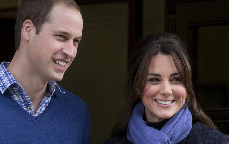 FILE - This is a Thursday, Dec. 6, 2012  file photo of  Britain's Prince William stand next to his wife Kate, Duchess of Cambridge as she leaves the King Edward VII hospital in central London. With Prince William and the former Kate Middleton expecting their first child in mid-July _ and much of the world interested in the birth of a future monarch _ officials at Clarence House have released some of the couple's plans, although many details are still being kept private. Kate has made several public appearances recently but is expected to keep a low profile in the final weeks of her pregnancy.  (AP Photo/Alastair Grant, File)