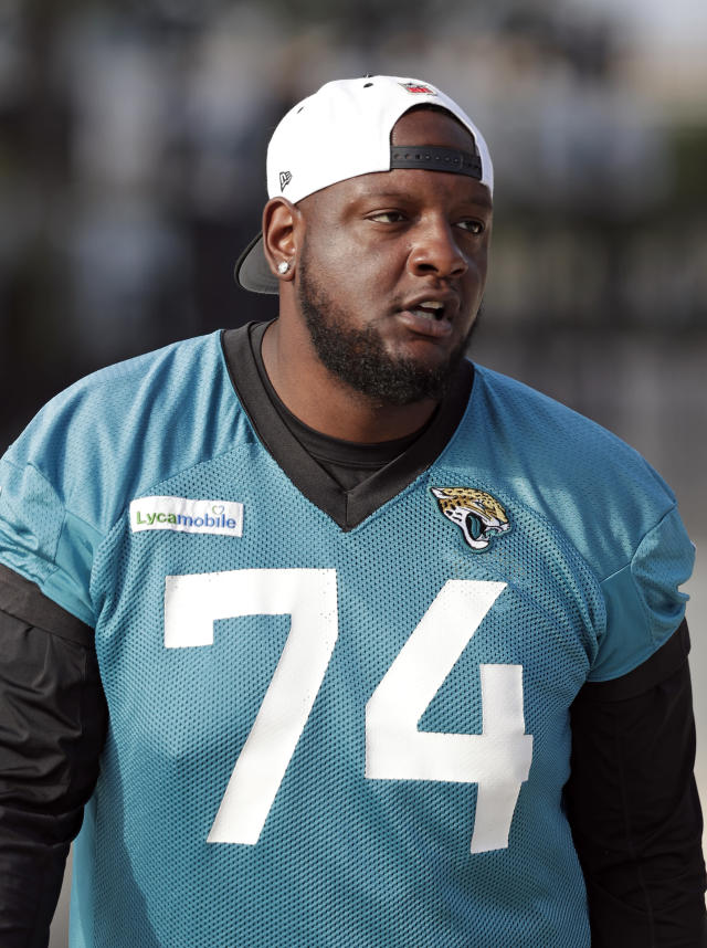 Jacksonville Jaguars offensive tackle Cam Robinson walks to the field at an NFL football practice, Tuesday, June 11, 2019, in Jacksonville, Fla. (AP Photo/John Raoux)