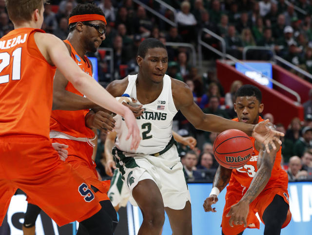 Michigan State forward Jaren Jackson Jr. (2) loses the ball as Syracuse guard Frank Howard (23) knocks it loose during the first half of an NCAA men's college basketball tournament second-round game in Detroit, Sunday, March 18, 2018. (AP Photo/Paul Sancya)