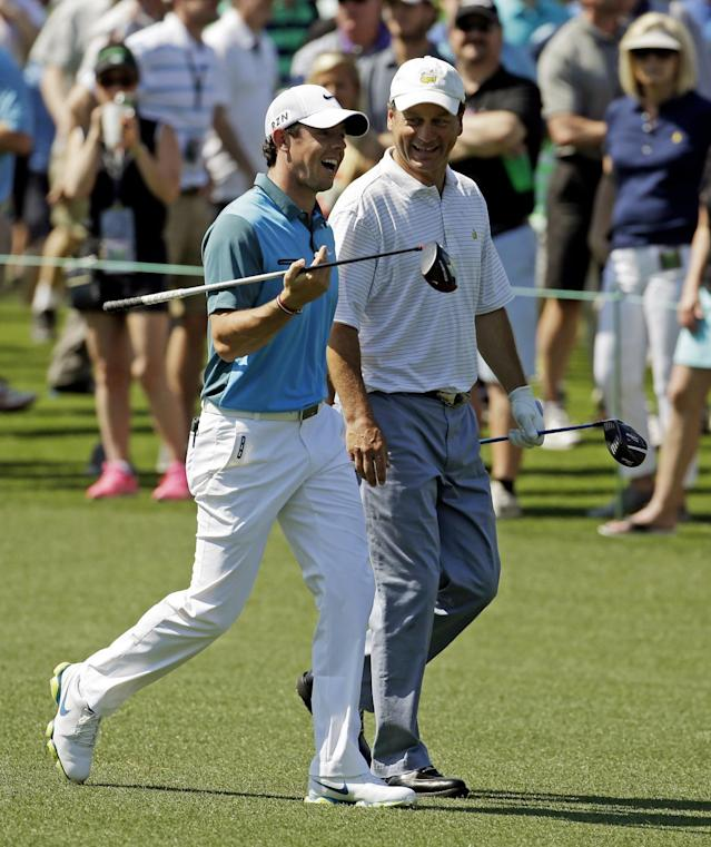 Rory McIlroy, of Northern Ireland, walks with Jeff Knox, right, down the eighth fairway during the third round of the Masters golf tournament Saturday, April 12, 2014, in Augusta, Ga. (AP Photo/Darron Cummings)