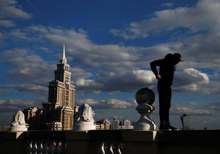 Grigory Shukhov of Rudex team stands on a parapet of a rooftop in Moscow, Russia, May 13, 2017. REUTERS/Maxim Shemetov