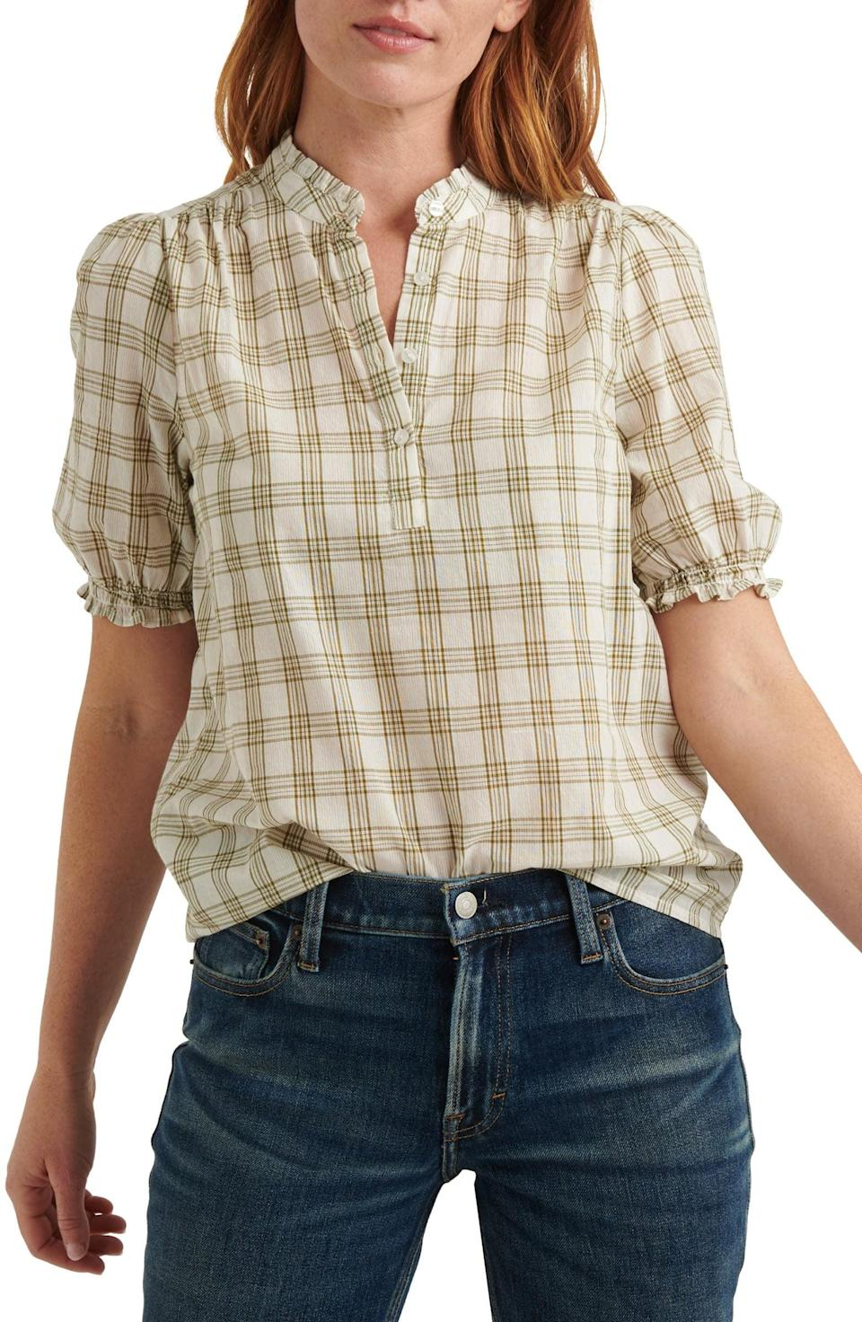 <p>This preppy <span>Lucky Brand Frill Popover Top</span> ($80) will look good with your favorite jeans.</p>