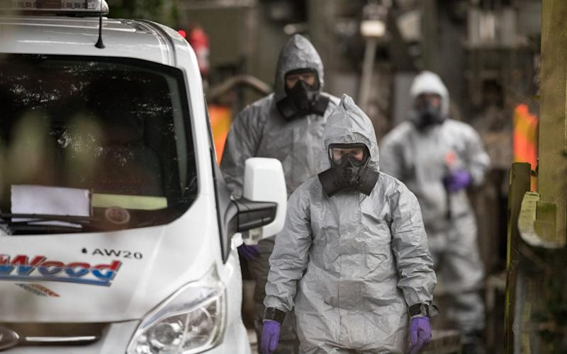 Investigators in protective clothing more than a week afterSergei Skripa and his daughter were found unconscious - Getty Images Europe