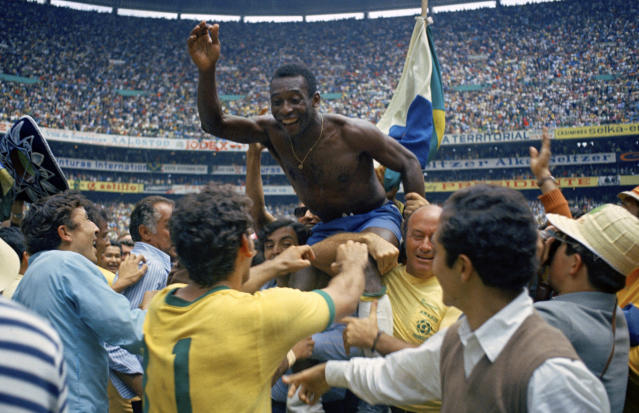 """FILE - In this June 21, 1970 file photo, Brazil's Pele is hoisted on shoulders of his teammates after Brazil won the World Cup final against Italy, 4-1, in Mexico City's Estadio Azteca. With one week to go before the World Cup starts in Brazil, The Associated Press takes a look at 10 great stars in the tournament's history. Pele Considered by many the greatest player in football history, Pele won three World Cup titles with Brazil. He was a teenager when he helped the """"Selecao"""" lift the trophy in 1958, then four years later he won the title again despite playing only one match because of an injury. Pele's career was at its peak when he led Brazil to victory in 1970. He remains the only player to win three World Cup titles. (AP Photo/File)"""