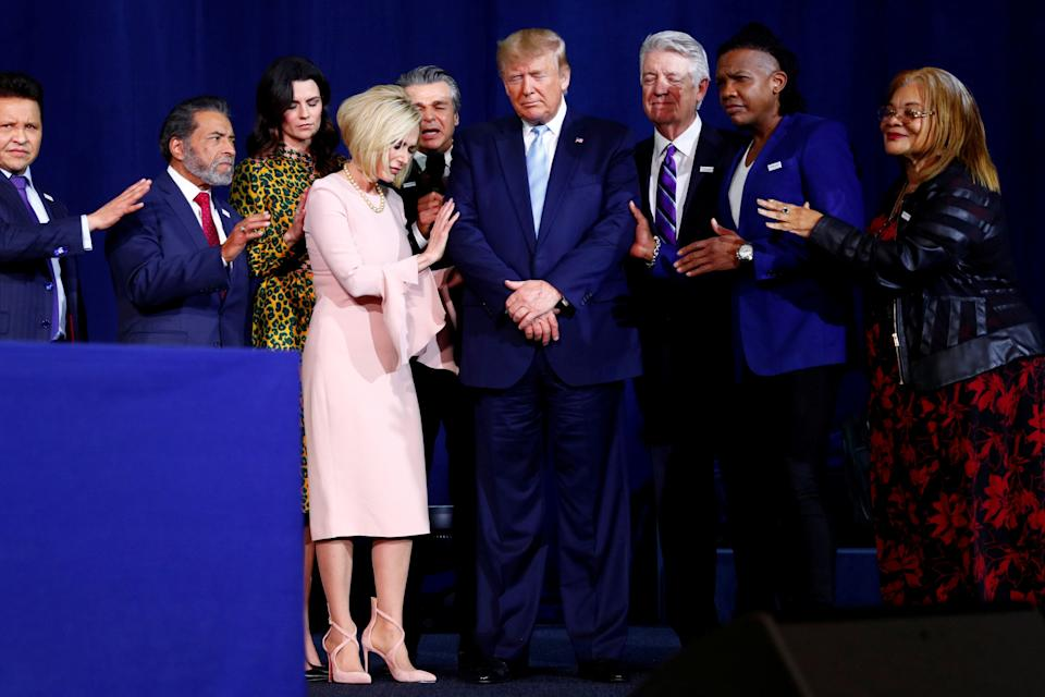 President Donald Trump participates in a prayer before speaking at an Evangelicals for Trump coalition launch at the King Jesus International Ministry in Miami on Jan. 3, 2020. (Photo: Tom Brenner/Reuters)