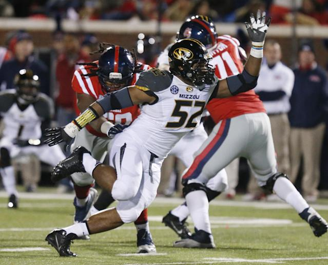 FILE - In this Nov. 23, 2013 file photo, Missouri defensive lineman Michael Sam (52) pushes past a block by Mississippi offensive linesman Pierce Burton (71) in the second half of a NCAA college football game in Oxford, Miss. Michael Sam hopes his ability is all that matters, not his sexual orientation. Missouri's All-America defensive end came out to the entire country Sunday night, Feb. 9, 2014, and could become the first openly gay player in America's most popular sport. (AP Photo/Rogelio V. Solis, File)