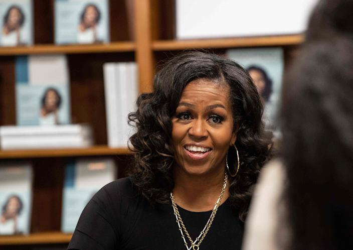 "Former first lady Michelle Obama meets with fans during a book signing on the first anniversary of the launch of her memoir ""Becoming"" at the Politics and Prose bookstore in Washington, D.C., in 2019. Her bestseller boosted the fortunes of black-owned bookstores."
