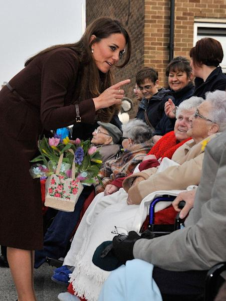 Britain's Catherine, Duchess of Cambridge talks a group of residents of the nearby St.Andrews Hospice during her visit to Humberside Fire and Rescue Station in Grimsby, Engalnd, Tuesday March 5, 2013. Her Royal Highness met many local people and people involved in a personal development course run by The Prince's Trust and delivered in partnership with Humberside Fire and Rescue Service. (AP Photo / Bruce Adams)