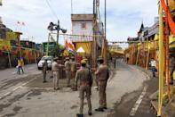 Police stand guard at a road before the arrival of India's Prime Minister to participate in a groundbreaking ceremony of the Ram Temple in Ayodhya on August 5, 2020. - India's Prime Minister Narendra Modi will lay the foundation stone for a grand Hindu temple in a highly anticipated ceremony on August 5 at a holy site that was bitterly contested by Muslims, officials said. The Supreme Court ruled in November 2019 that a temple could be built in Ayodhya, where Hindu zealots demolished a 460-year-old mosque in 1992. (Photo by Sanjay KANOJIA / AFP) (Photo by SANJAY KANOJIA/AFP via Getty Images)