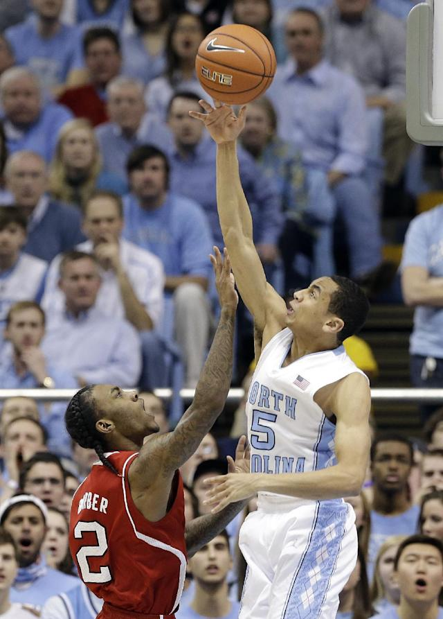 North Carolina's Marcus Paige (5) blocks North Carolina State's Anthony Barber (2) during the first half of an NCAA college basketball game in Chapel Hill, N.C., Saturday, Feb. 1, 2014. (AP Photo/Gerry Broome)