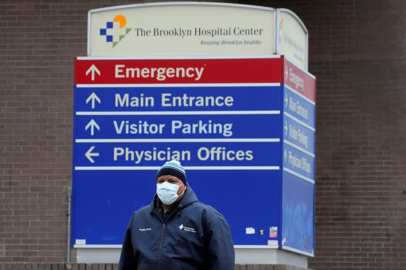FILE PHOTO: A health worker exits the Brooklyn Hospital Center, during the coronavirus disease (COVID-19) outbreak in Brooklyn, New York