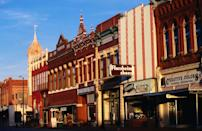<p>Main Street in Guthrie, Oklahoma is known for its marquees, murals, and ghost signs.</p>