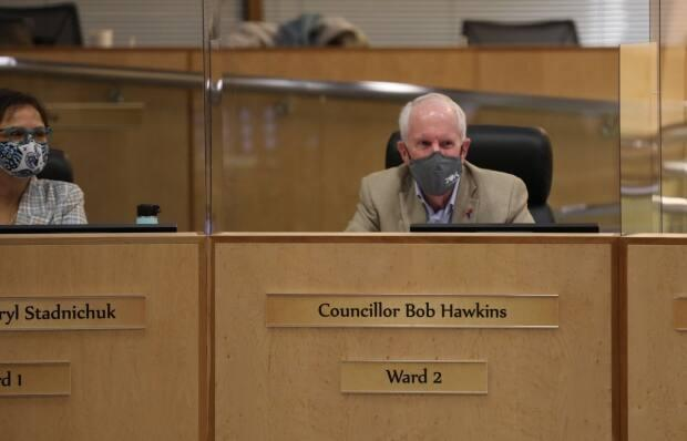 Councillor Bob Hawkins says funding police and looking into the root causes of crime are not an either or situation. He says both should be a priority.