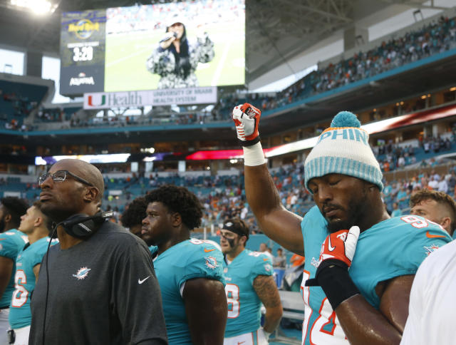 Dolphins defensive end Robert Quinn raises his right fist during the national anthem Thursday before the team's preseason game against the Buccaneers. (AP)