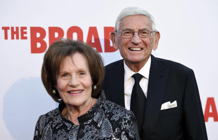 FILE - In this Sept. 17, 2015, file photo, Eli Broad, right, founder of The Broad museum, arrives with his wife Edythe at the museum's opening in Los Angeles. Eli Broad, the billionaire philanthropist, contemporary art collector and entrepreneur who co-founded homebuilding pioneer Kaufman and Broad Inc. and launched financial services giant SunAmerica Inc., died Friday, April 30, 2021 in Los Angeles. He was 87. (Photo by Chris Pizzello/Invision/AP, File)