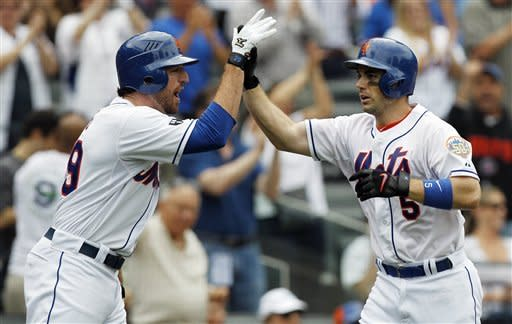 New York Mets on-deck batter Ike Davis, left, greets David Wright at the plate after Wright hit a three-run home run during the fifth inning of a baseball game against the Pittsburgh Pirates at Citi Field in New York, Thursday, Sept. 27, 2012. (AP Photo/Kathy Willens)
