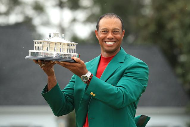 Tiger Woods celebrates with the Masters Trophy during the Green Jacket Ceremony after winning the Masters at Augusta National Golf Club. (Photo by Andrew Redington/Getty Images)