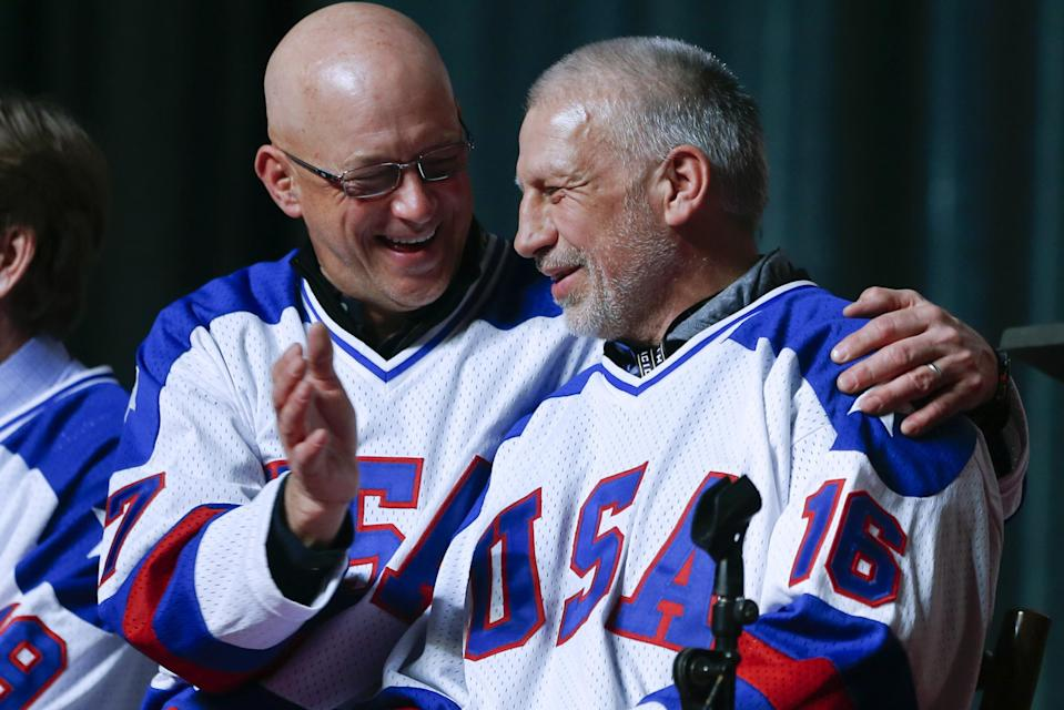 Jack O'Callahan, left, and Mark Pavelich of the 1980 U.S. ice hockey team talk during a