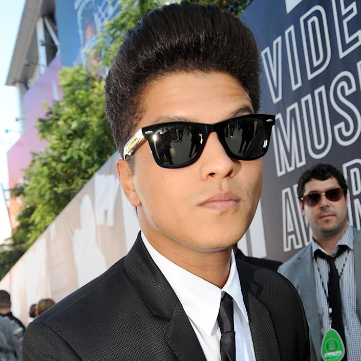 <p>Mars arrived at the 2010 MTV Video Music Awards sporting his now-famous pompadour. </p>