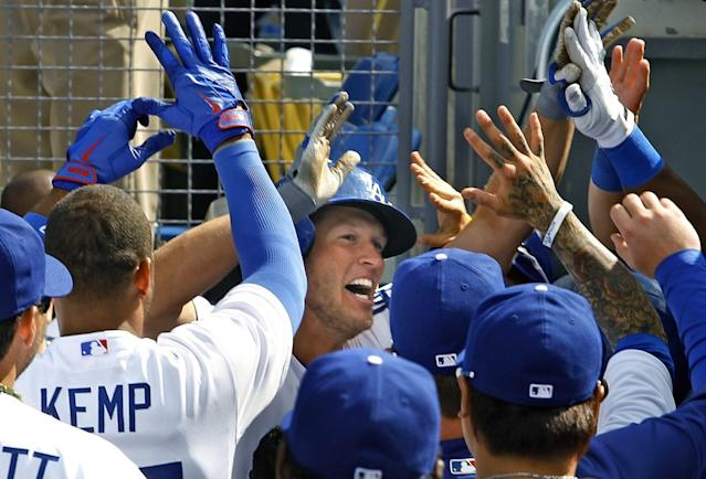 """Clayton Kershaw celebrates after hitting a home run against the San Francisco Giants on opening day 2013 at Dodger Stadium. <span class=""""copyright"""">(Christina House / Los Angeles Times)</span>"""