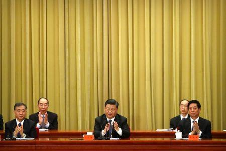 """Chinese President Xi Jinping applauds during an event to commemorate the 40th anniversary of the """"Message to Compatriots in Taiwan"""" at the Great Hall of the People in Beijing, China January 2, 2019. REUTERS/Mark Schiefelbein/Pool"""