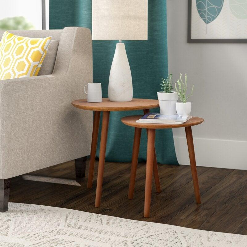 "<h3><a href=""https://www.wayfair.com/furniture/pdp/langley-street-creenagh-2-piece-nesting-tables-lgly5832.html"" rel=""nofollow noopener"" target=""_blank"" data-ylk=""slk:Langley Street Creenagh 2-Piece Nesting Tables"" class=""link rapid-noclick-resp"">Langley Street Creenagh 2-Piece Nesting Tables</a></h3><br><strong>When you need (but can't sacrifice) more table space</strong>: Go the nesting-table route — this compact side-table duo is ready to open up surface area wherever you need it and stack up wherever you don't.<br><br><strong>Langley Street</strong> Creenagh 2 Piece Nesting Tables, $, available at <a href=""https://go.skimresources.com/?id=30283X879131&url=https%3A%2F%2Fwww.wayfair.com%2Ffurniture%2Fpdp%2Flangley-street-creenagh-2-piece-nesting-tables-lgly5832.html"" rel=""nofollow noopener"" target=""_blank"" data-ylk=""slk:Wayfair"" class=""link rapid-noclick-resp"">Wayfair</a>"