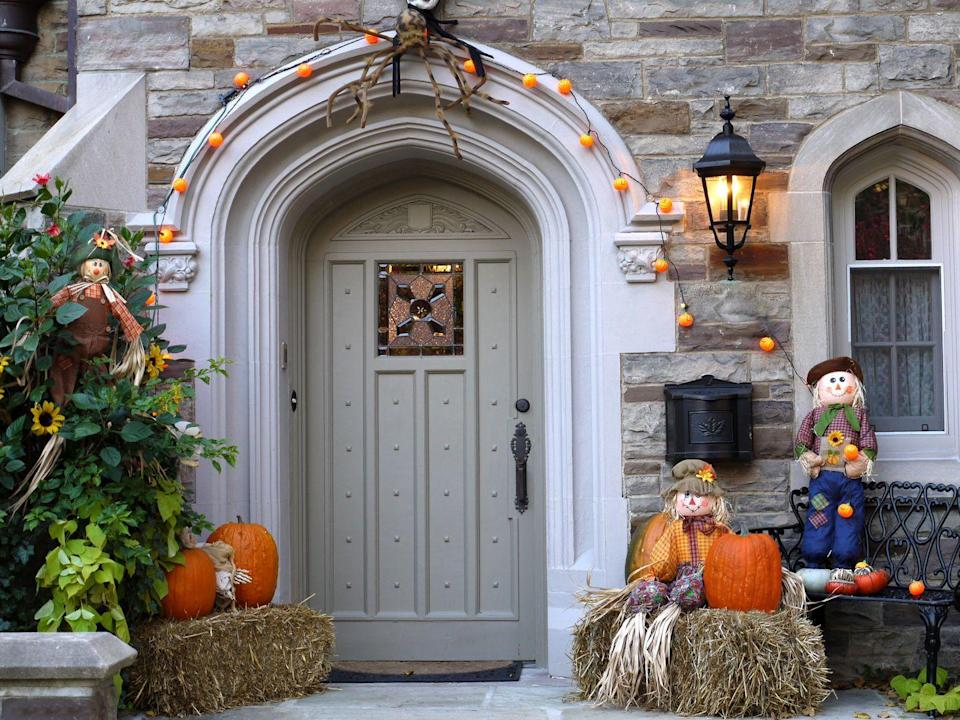 """<p>There's no doubt that your neighbors will be amused by a couple of scarecrows hanging out near your front door. <br><br><a class=""""link rapid-noclick-resp"""" href=""""https://go.redirectingat.com?id=74968X1596630&url=https%3A%2F%2Fwww.wayfair.com%2Fholiday-decor%2Fpdp%2Fthe-holiday-aisle-halloween-scarecrow-pumpkin-head-decor-dbgt1619.html&sref=https%3A%2F%2Fwww.goodhousekeeping.com%2Fholidays%2Fhalloween-ideas%2Fg32948621%2Fhalloween-door-decorations%2F"""" rel=""""nofollow noopener"""" target=""""_blank"""" data-ylk=""""slk:SHOP SCARECROW DECOR"""">SHOP SCARECROW DECOR</a> </p>"""