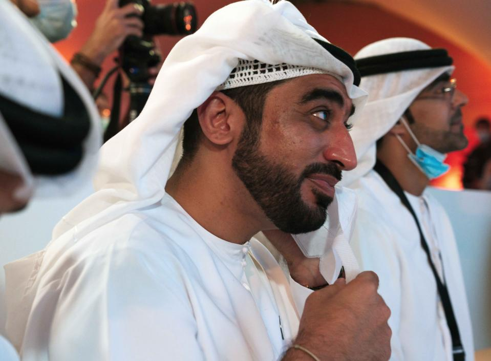 "An Emirati man wipes a tear away with his face mask due to the coronavirus pandemic while watching the launch of the ""Amal"" or ""Hope"" space probe at the Mohammed bin Rashid Space Center in Dubai, United Arab Emirates, Monday, July 20, 2020. A United Arab Emirates spacecraft, the ""Amal"" or ""Hope"" probe, blasted off to Mars from Japan early Monday, starting the Arab world's first interplanetary trip. (AP Photo/Jon Gambrell)"