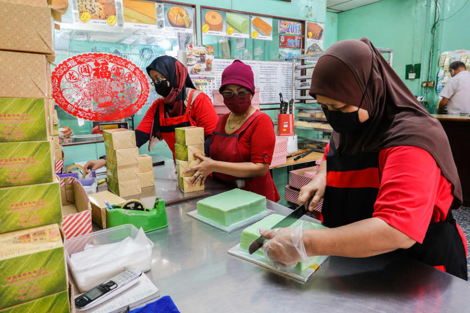 Workers of Pandan Layer Bakery busy preparing their signature pandan layer cake for customers during the movement control order 3.0 (MCO 3.0) in Klang June 23, 2021.