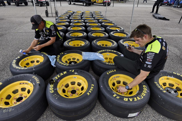 Driver Paul Menard crew members prepare tires before a NASCAR Cup Series auto race Sunday, Sept. 1, 2019, at Darlington Raceway in Darlington, S.C. (AP Photo/Richard Shiro)