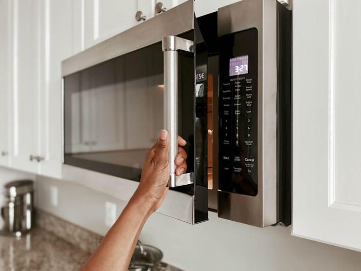 """<p>According to <em>The Pioneer Woman</em>, you should avoid using heavy-duty oven cleaners, bleach, and other abrasive chemical solutions to clean your microwave, which can damage the appliance's interior. Instead, <a href=""""https://www.thepioneerwoman.com/food-cooking/cooking-tips-tutorials/a32292702/how-to-clean-microwave/"""" rel=""""nofollow noopener"""" target=""""_blank"""" data-ylk=""""slk:try washing your microwave with dish soap"""" class=""""link rapid-noclick-resp"""">try washing your microwave with dish soap</a>. To make the process easier, start with a steam-clean. Simply heat one cup of water in the microwave for two or three minutes. Then leave the door closed for a few more minutes, allowing the microwave to fill with steam. </p><p>If a steam-clean and dish soap don't do the trick, apply a paste of baking soda and water to the interior of the microwave and wipe down with a microfiber cloth. Don't forget to wipe down the microwave's exterior with soap and water as well!</p>"""
