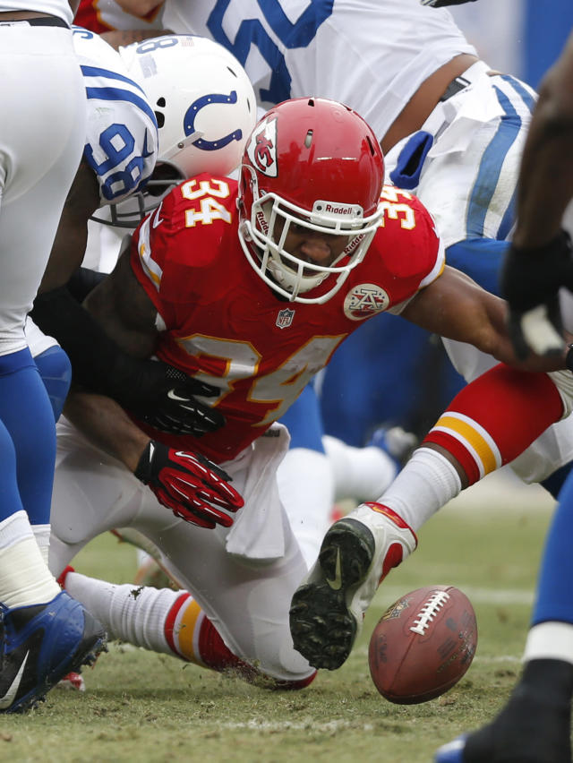 Kansas City Chiefs running back Knile Davis (34) fumbles the ball when hit by Indianapolis Colts outside linebacker Robert Mathis (98) during the first half of an NFL football game at Arrowhead Stadium in Kansas City, Mo., Sunday, Dec. 22, 2013. Colts recovered the ball on the play. (AP Photo/Ed Zurga)