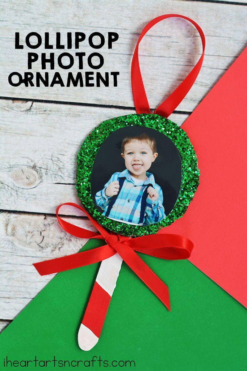 "<p>Create personalized ornaments with your child's school pictures. They'll look great hanging on your tree and make for great <a href=""https://www.countryliving.com/shopping/gifts/g24995746/grandpa-gifts/"" rel=""nofollow noopener"" target=""_blank"" data-ylk=""slk:gifts for grandpa"" class=""link rapid-noclick-resp"">gifts for grandpa</a> and grandma, too.</p><p><strong>Get the tutorial at <a href=""https://www.iheartartsncrafts.com/lollipop-photo-ornament-craft-kids/"" rel=""nofollow noopener"" target=""_blank"" data-ylk=""slk:I Heart Arts 'n Crafts"" class=""link rapid-noclick-resp"">I Heart Arts 'n Crafts</a>.</strong></p><p><a class=""link rapid-noclick-resp"" href=""https://www.amazon.com/Topenca-Supplies-Inches-Double-Ribbon/dp/B01ENR5GXQ/ref=sr_1_1_sspa?tag=syn-yahoo-20&ascsubtag=%5Bartid%7C10050.g.5030%5Bsrc%7Cyahoo-us"" rel=""nofollow noopener"" target=""_blank"" data-ylk=""slk:SHOP RED RIBBON"">SHOP RED RIBBON</a></p>"