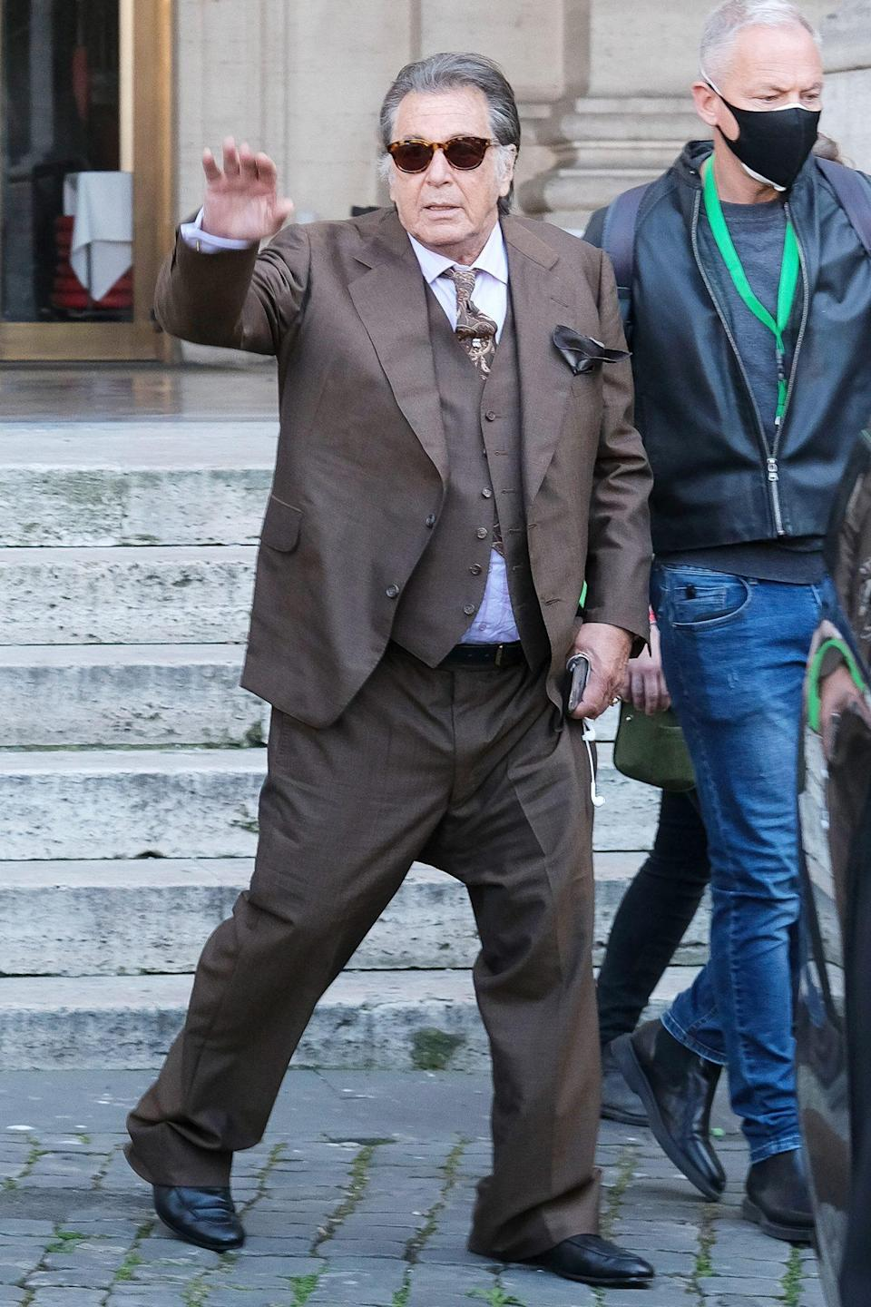 <p>Al Pacino waves to fans while on the set of <i>House of Gucci </i>on Monday in Milan. </p>