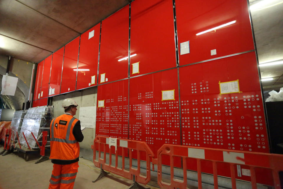 <p>Glass panels with a Soho street map go up at Tottenham Court Road station. </p>