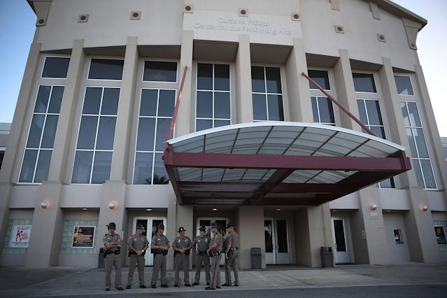 <p>Florida Highway Patrol officers stand outside the Curtis M. Phillips Center for the Performing Arts as they prepare the venue for Thursday's scheduled speech by white nationalist Richard Spencer on Oct. 18, 2017 in Gainesville, Fla. Reports indicate security for the event will cost about $500,000. (Phot: Joe Raedle/Getty Images) </p>