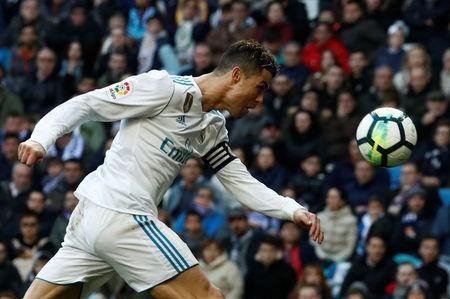 Soccer Football - La Liga Santander - Real Madrid vs Deportivo Alaves - Santiago Bernabeu, Madrid, Spain - February 24, 2018 Real Madrid's Cristiano Ronaldo heads at goal REUTERS/Juan Medina