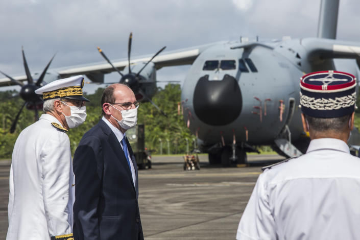 France's Prime Minister Jean Castex, second from left, arrives at the Matoury Air Base 367, near Cayenne, French Guiana, Sunday, July 12, 2020. As virus numbers soar in French Guiana, France's new prime minister traveled Sunday to the South American territory and promised not to ignore its suffering. (AP Photo/Pierre-Olivier Jay)