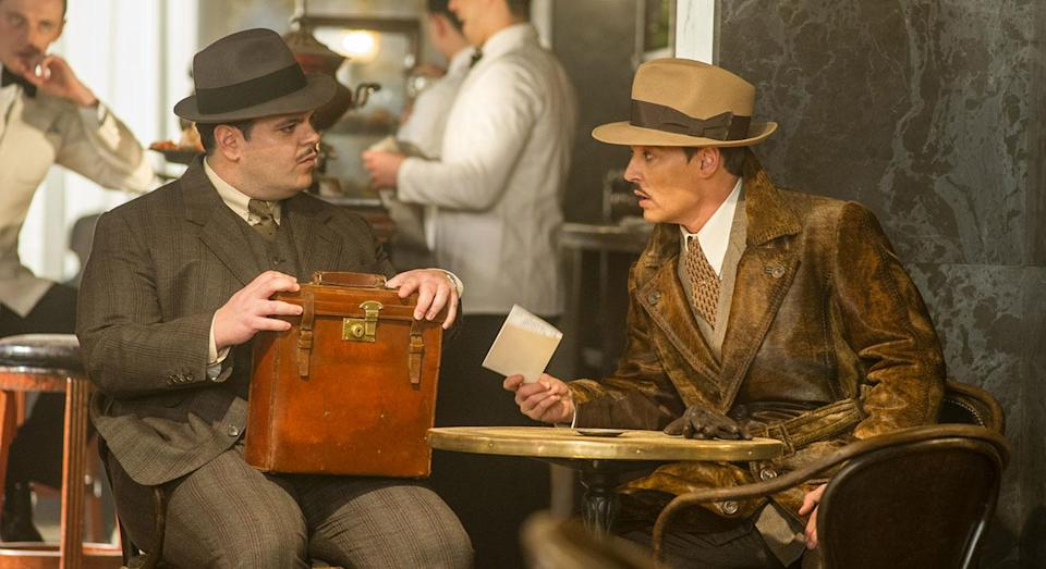 Hector MacQueen (Josh Gad) and Ratchett (Johnny Depp) in 'Murder on the Orient Express' (20th Century Fox)