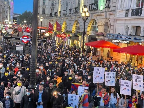 Hundreds of people from the Tibetan, Hong Kong and Uyghur communities protested in central London on Friday.