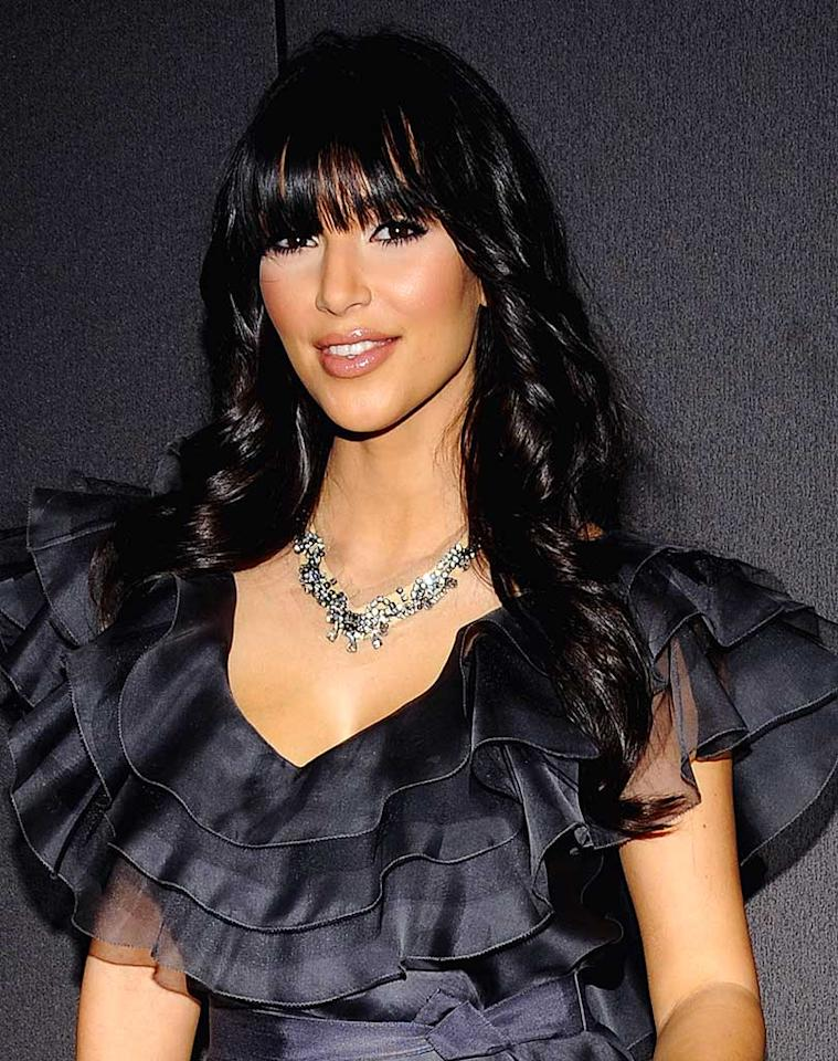 "Kim Kardashian's new 'do is anything but bangin'. George Napolitano/<a href=""http://www.filmmagic.com/"" target=""new"">FilmMagic.com</a> - December 1, 2008"