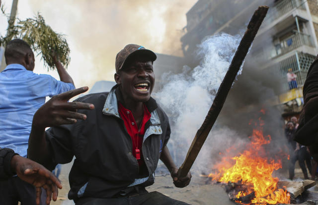 <p>Residents of the Mathare area of Nairobi, Kenya, take to the streets by blocking roads with burning tyres to protest in support of Kenyan opposition leader and presidential candidate Raila Odinga, Wednesday Aug. 9, 2017. (Photo: Brian Inganga/AP) </p>
