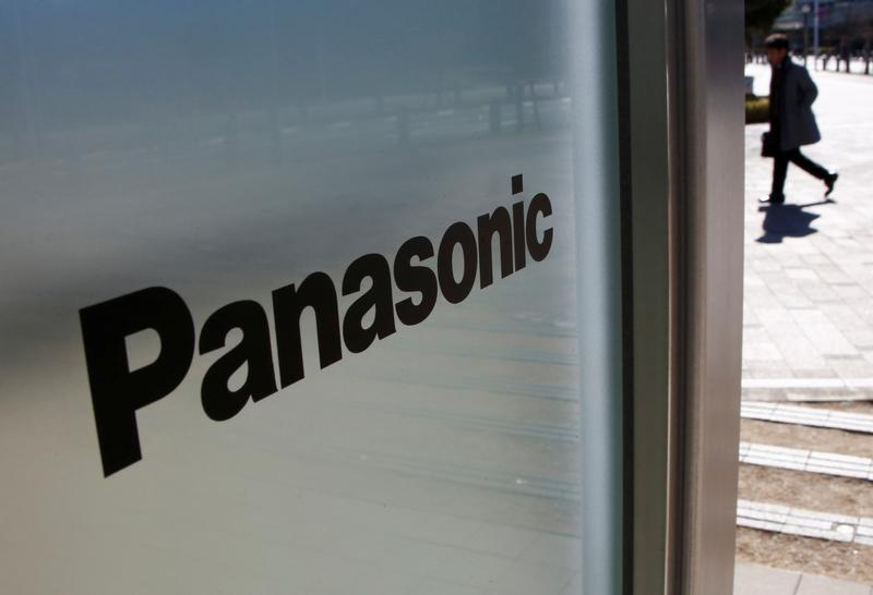 A man is seen next to Panasonic Corp's logo at Panasonic Center in Tokyo
